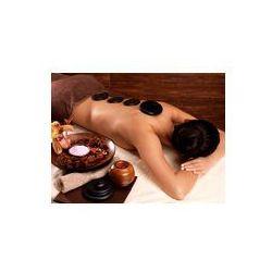 Foto naklejka samoprzylepna 100 x 100 cm - Kobieta o kamień do masażu w salonie spa