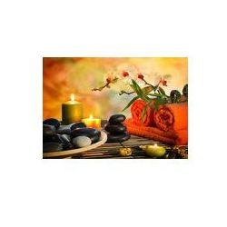 Foto naklejka samoprzylepna 100 x 100 cm - Przygotowanie do masażu w pomarańczowych świateł i czarnych kamieni