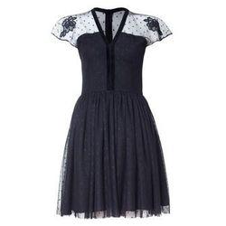 Sukienka z czarnego tiulu w groszki wykończona aksamitką
