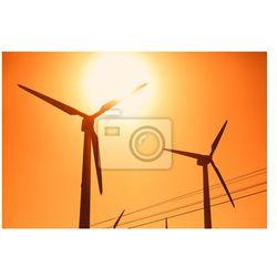 Obraz Elektryczne sylwetki turbiny wiatrowej na tle słońca